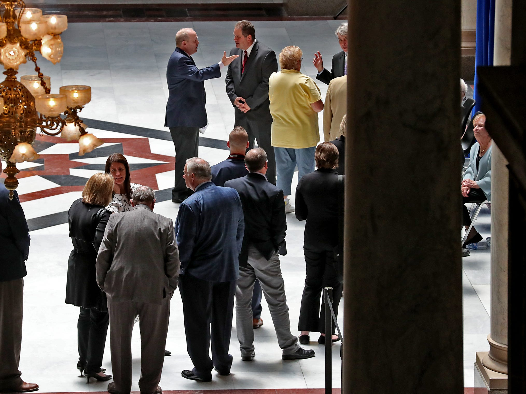 As Former Senator and Mayor Richard Lugar lies in state under the Statehouse rotunda, Tuesday, May 14, 2019, his family sees people paying their respects.