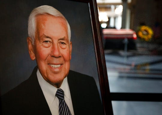 A portrait of former Senator and Mayor Richard Lugar smiles as he lies in state nearby, under the Statehouse rotunda, Tuesday, May 14, 2019.