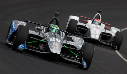 Conor Daly (25) of Andretti Autosport and Santino Ferrucci (19) of Dale Coyne Racing round turn three during practice for the Indianapolis 500 at the Indianapolis Motor Speedway on Tuesday, May 14, 2019.