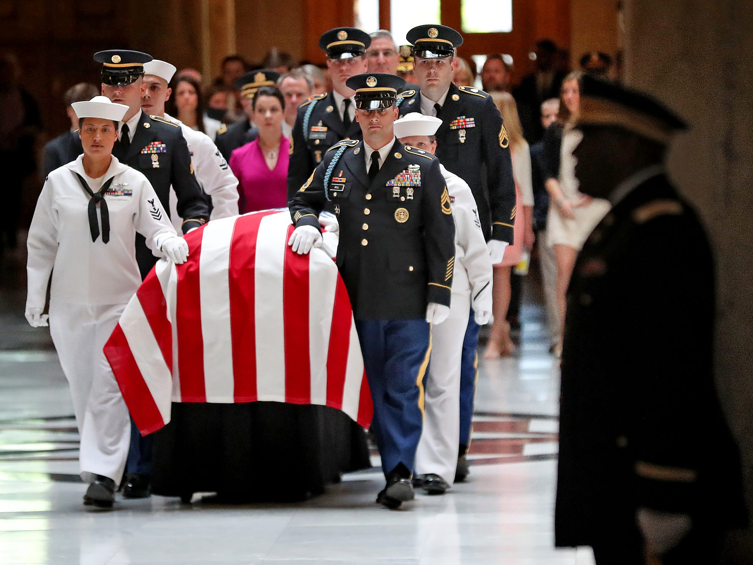 Former Senator and Mayor Richard Lugar is brought into the Statehouse where he lies in state, Tuesday, May 14, 2019.