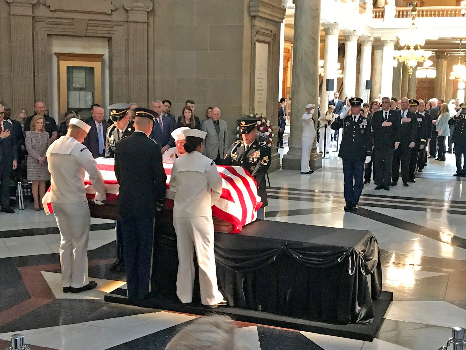 A military honor guard places the casket of former Indiana Senator Richard Lugar on the catafalque to lie in state in the rotunda of the State Capitol in Indianapolis, Tuesday, May 14, 2019.
