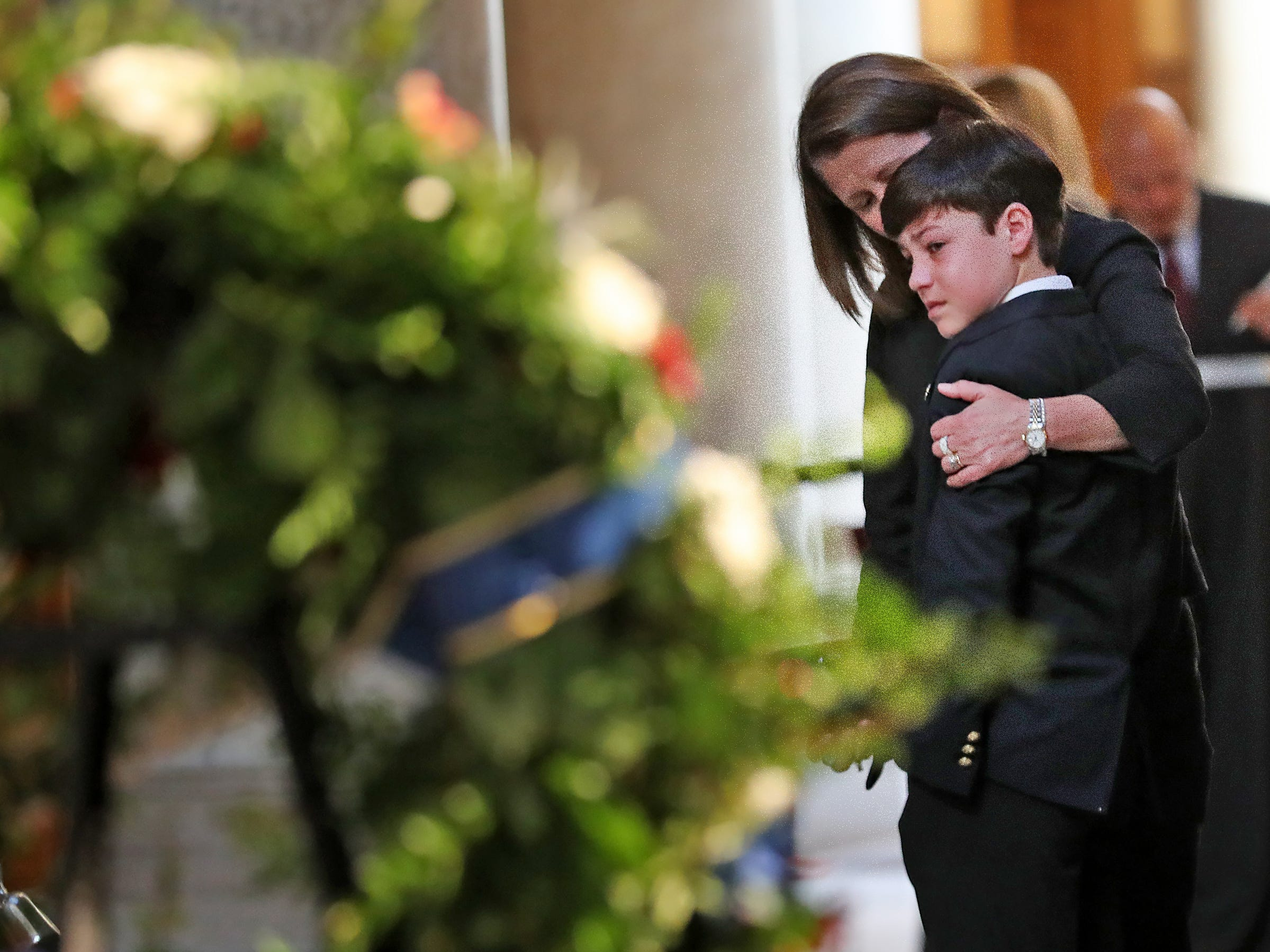 Family stop to see the flag-draped casket as former Senator and Mayor Richard Lugar lies in state under the Statehouse rotunda, Tuesday, May 14, 2019.  The public also paid their respects.