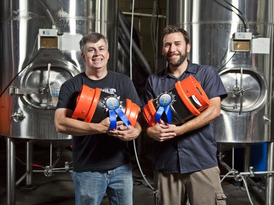 Dave Colt, left, and Clay Robinson co-founded Sun King Brewing Co. in 2009 with the help of family and friends.