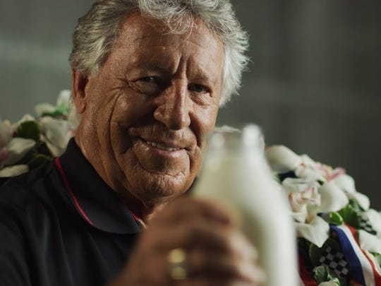 "Mario Andretti toasts the 50th anniversary of his Indy 500 victory in the film ""Drive Like Andretti."""