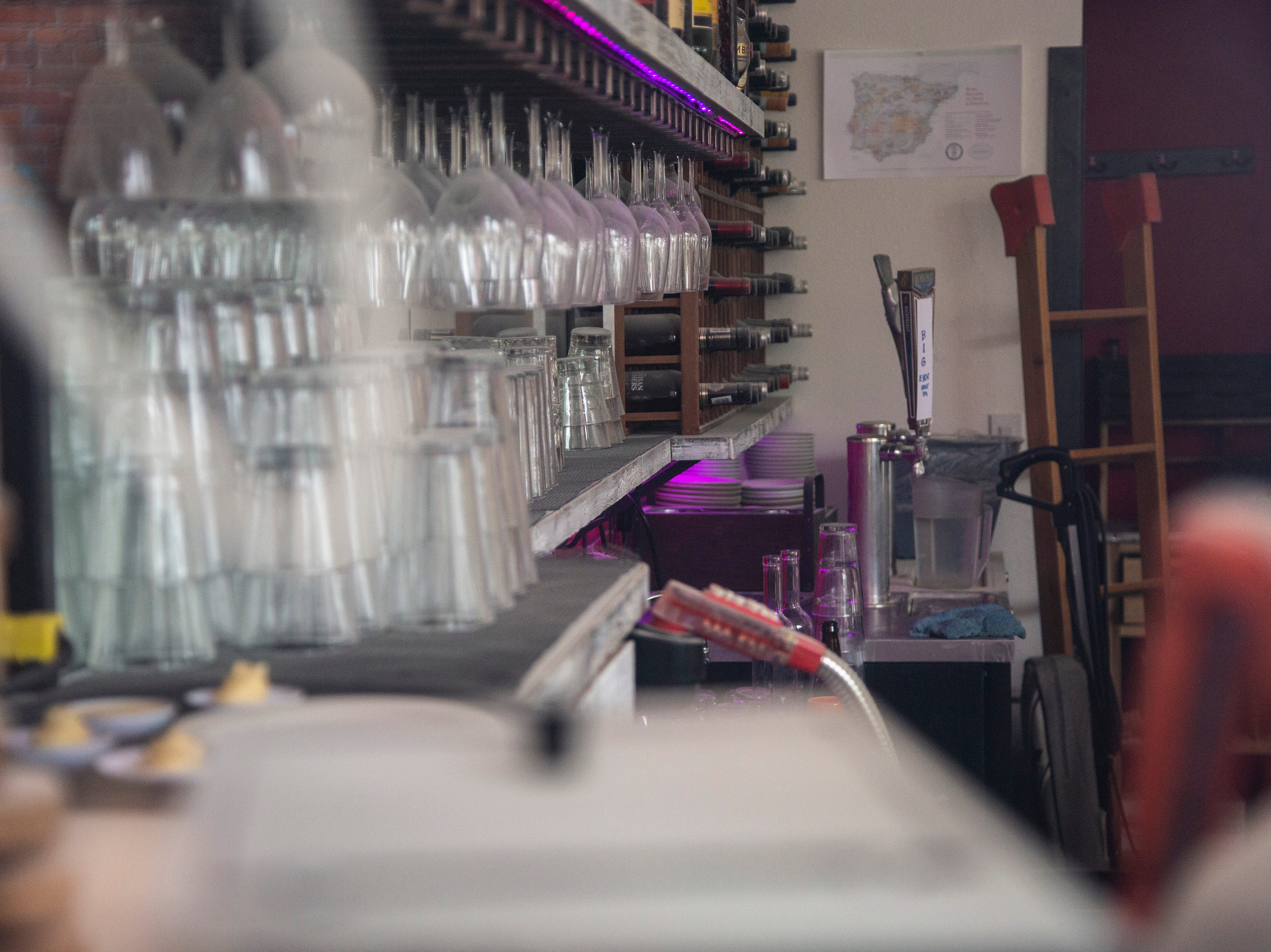 Glasses and bottles of wine are surrounded by damage, Tuesday, May 14, 2019, at Linn Street Dive in Iowa City, Iowa.