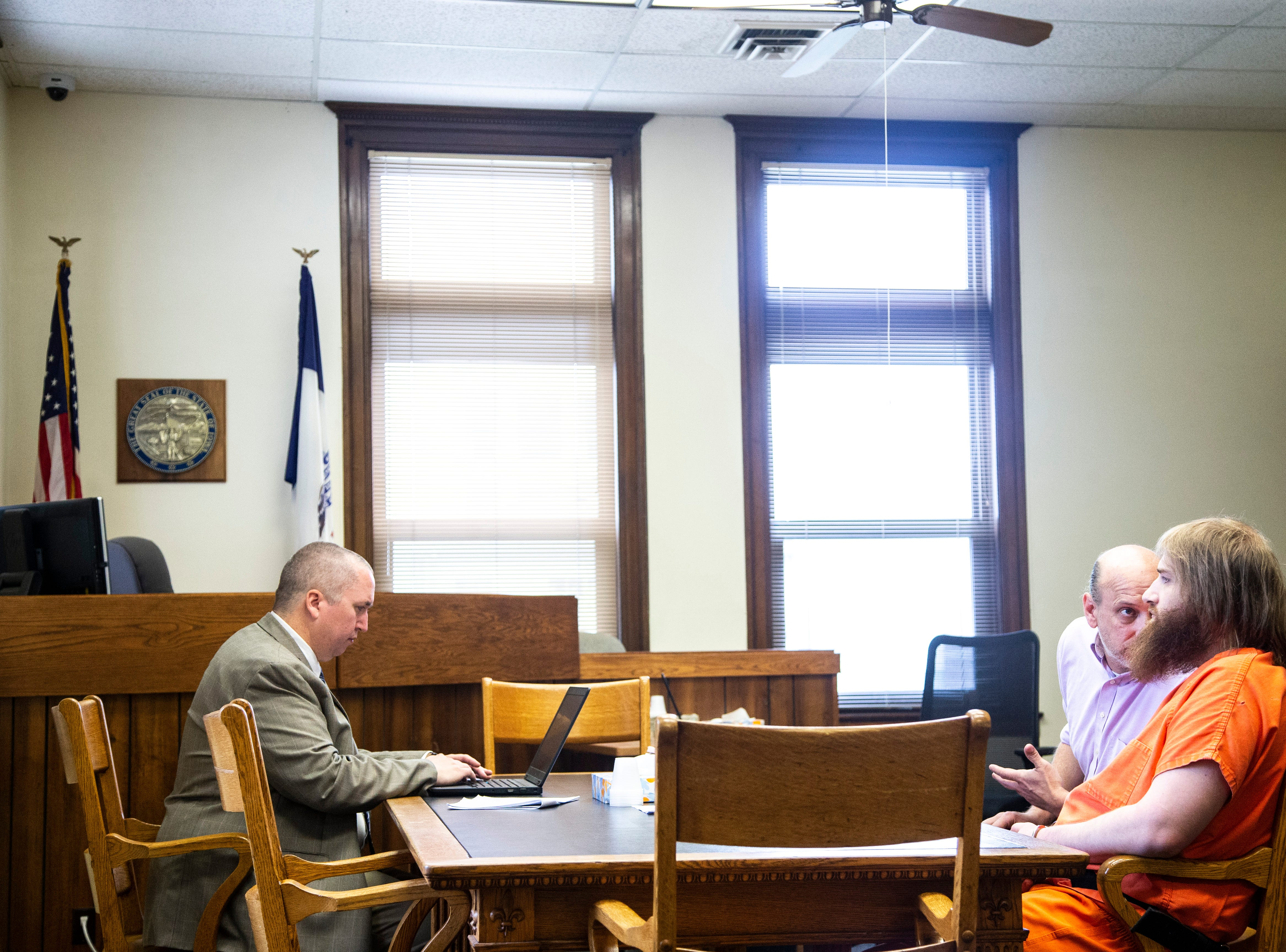 Defense attorney John Bruzek, second from right, talks with Flannery Kennedy-Meier during a sentencing hearing for attempted murder, Tuesday, May 14, 2019, at the Johnson County Courthouse in Iowa City, Iowa.