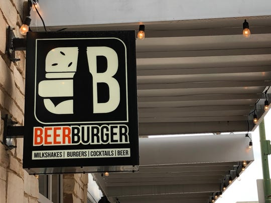 The sign outside of Beer Burger located at 180 E Burlington St.