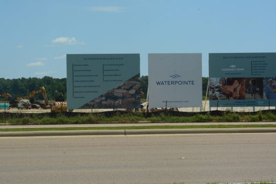 The Waterpointe development is expected to house 800 families in a collection of flats, condominiums, townhomes and houses, bringing in several millions of dollars in sales and property taxes to the city of Flowood.