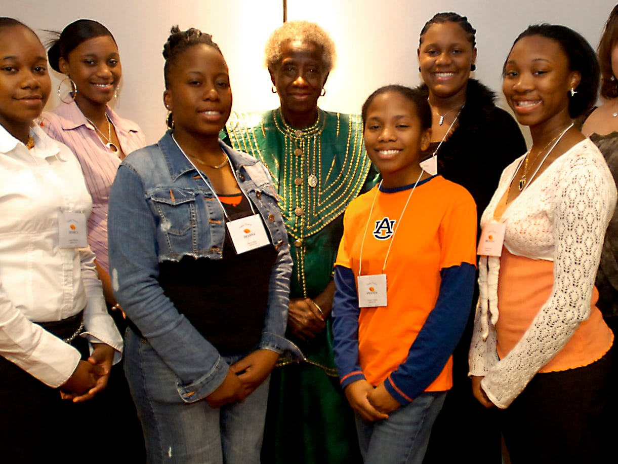 Jessica Patterson, (left), Raven Jenkins, Deanna Bracy, Unita Blackwell, Amanda Colman, Niaya Young, Brianna Adams, Jasmine Williams, and Teri McCreary are honored at the Sisters of Change Reception at the HIlton Garden Inn in Montgomery, Ala. Friday, November 10, 2006. (Montgomery Advertiser/Tammy McKinley)