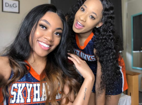 DeCora Alexander, right, poses with roommate and friend Lindsay Williams in their Skyhawks dance squad uniforms. Alexander was found dead in Union City at 20 years old on Saturday after an apparent homicide.
