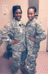 DeCora Alexander poses with her friend Aprecious McPhearson in Army uniforms. Alexander, who was found dead Saturday, was in the National Guard before she was medically discharged.