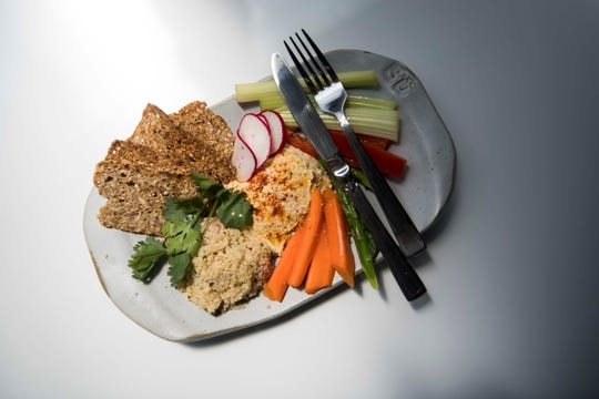 A hummus plate offered at Blühen Botanical's wellness and CBD product retail center on 111 East Jackson Ave in downtown Knoxville Tuesday, May 14, 2019.