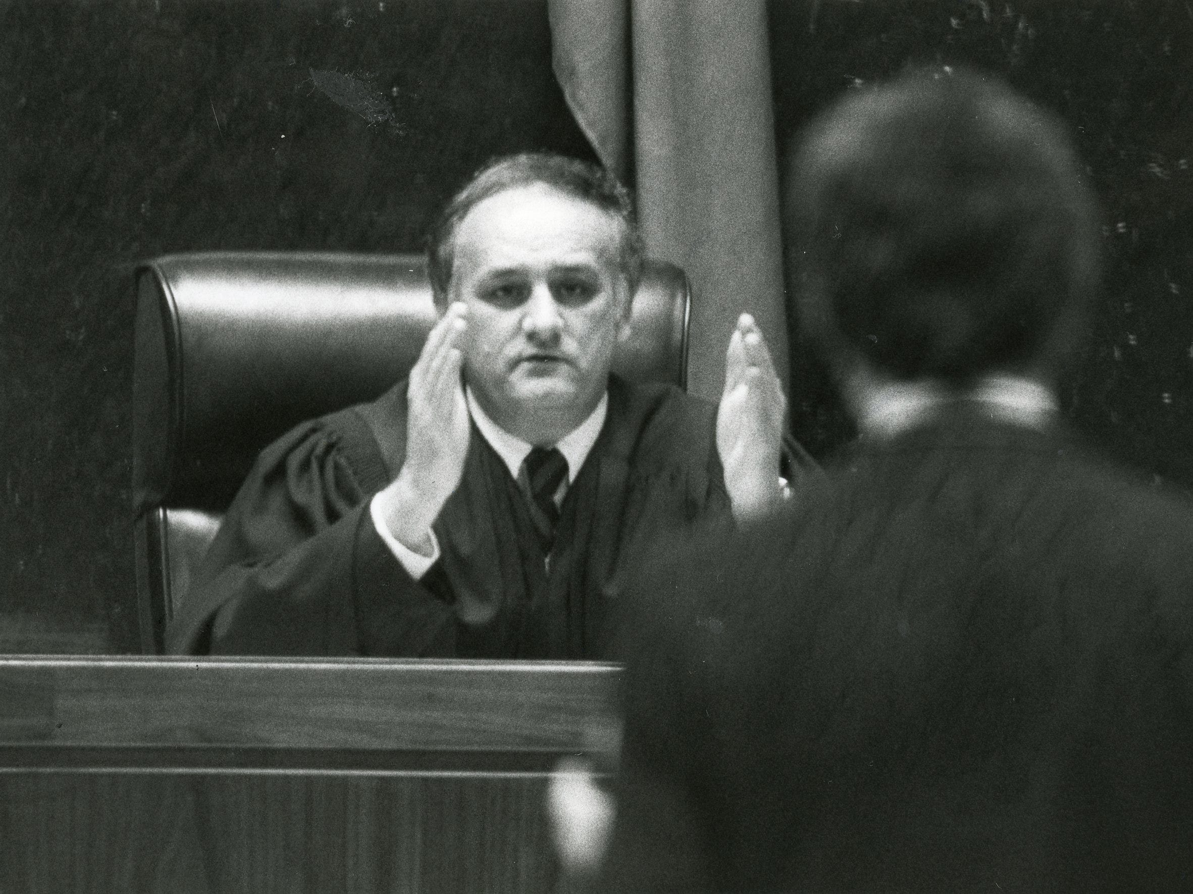 "Judge James B. ""Buddy"" Scott talks in court in March 1984."