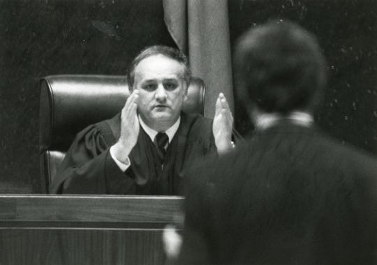 "Judge James B. ""Buddy"" Scott talks in court in March 1984."