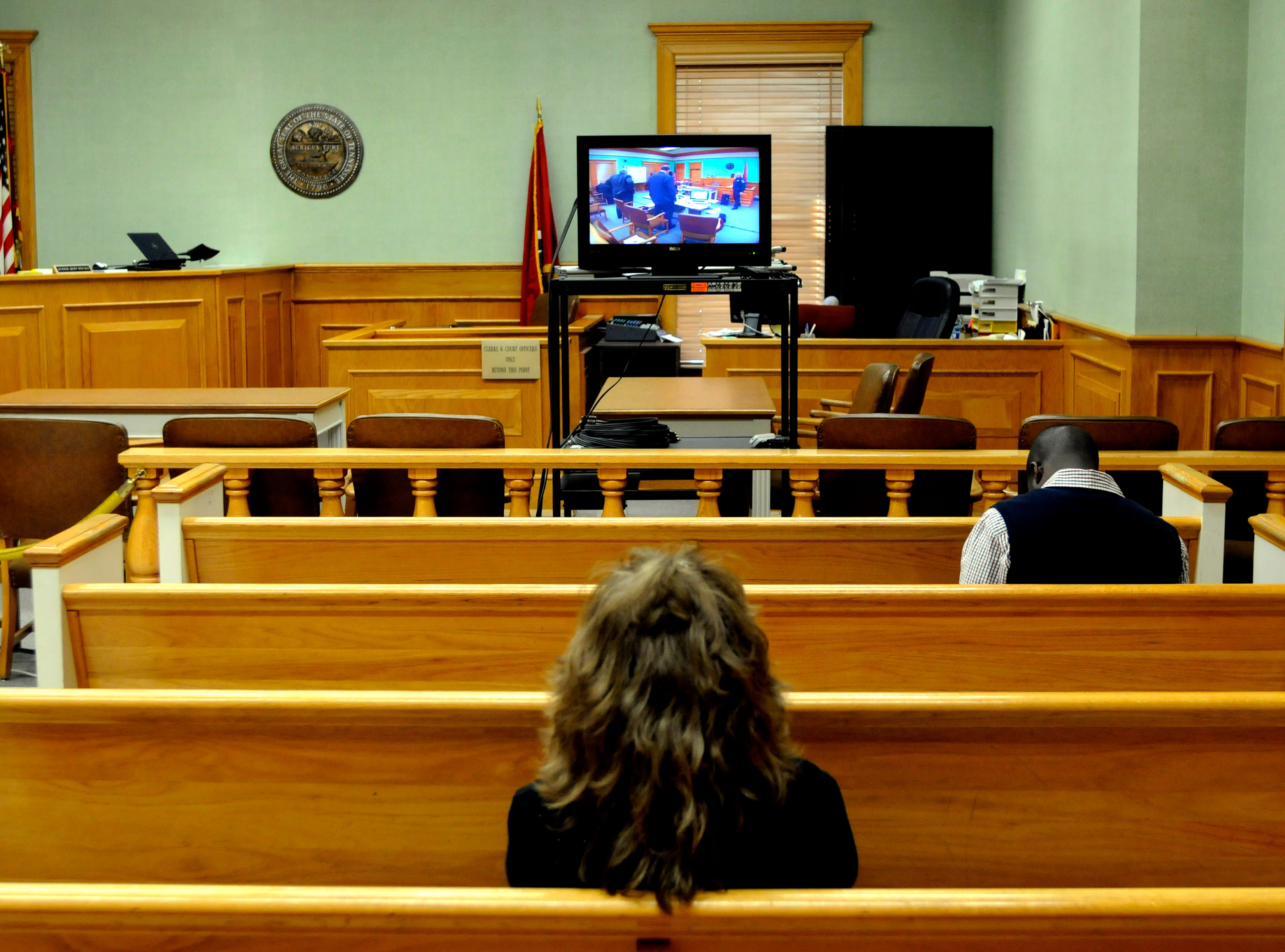 "Rocky Houston's sister, Debbie Cofer, sits in a separate courtroom where a monitor was set up for the public to view jury selection. Houston is on trial before Special Judge James R. ""Buddy"" Scott in Roane County Circuit Court. Houston is accused of ambushing Roane County Sheriff's Office Deputy William Birl Jones, 53, and ride-along Gerald Michael Brown, 44, in May 2006, killing them both. Houston, 45, contends he acted in self-defense.  Wednesday, December 3, 2008"