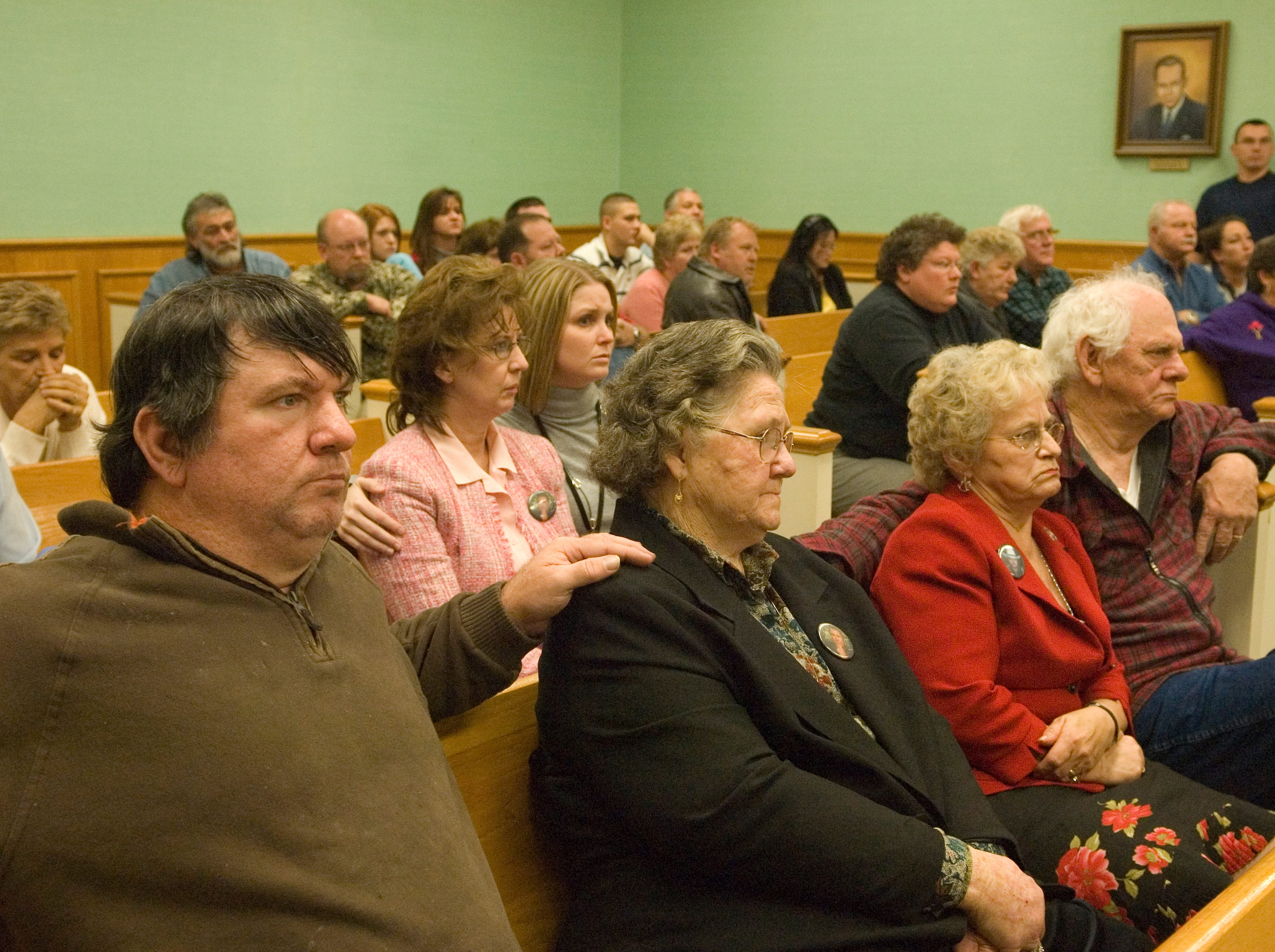 The families of Roane County Deputy Bill Jones and Mike Brown listen Friday as the jury announces its split verdict in the double-murder trial of Rocky Joe Houston. Friday, December 19, 2008