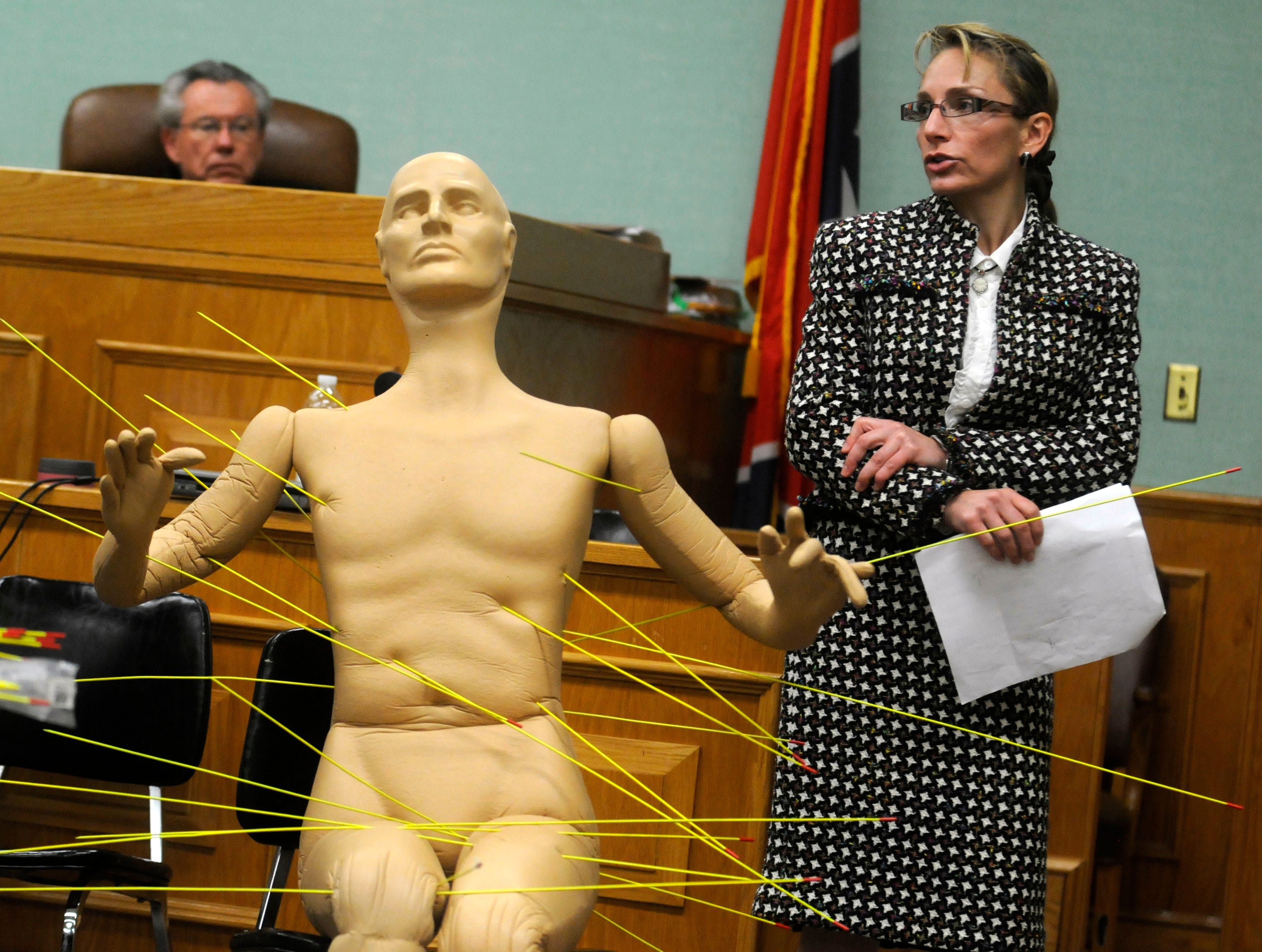 Knox County Chief Medical Examiner Dr. Darinka Mileusnic-Polchan used a mannequin and rods to demonstrate gunshots wounds suffered by Deputy Bill Jones during the double murder re-trial of Leon Houston Tuesday, Nov 10, 2009 in Roane County Circuit Court. Houston is accused of the May 2006 ambush murders of Jones and his ride-along friend Gerald Michael Brown.