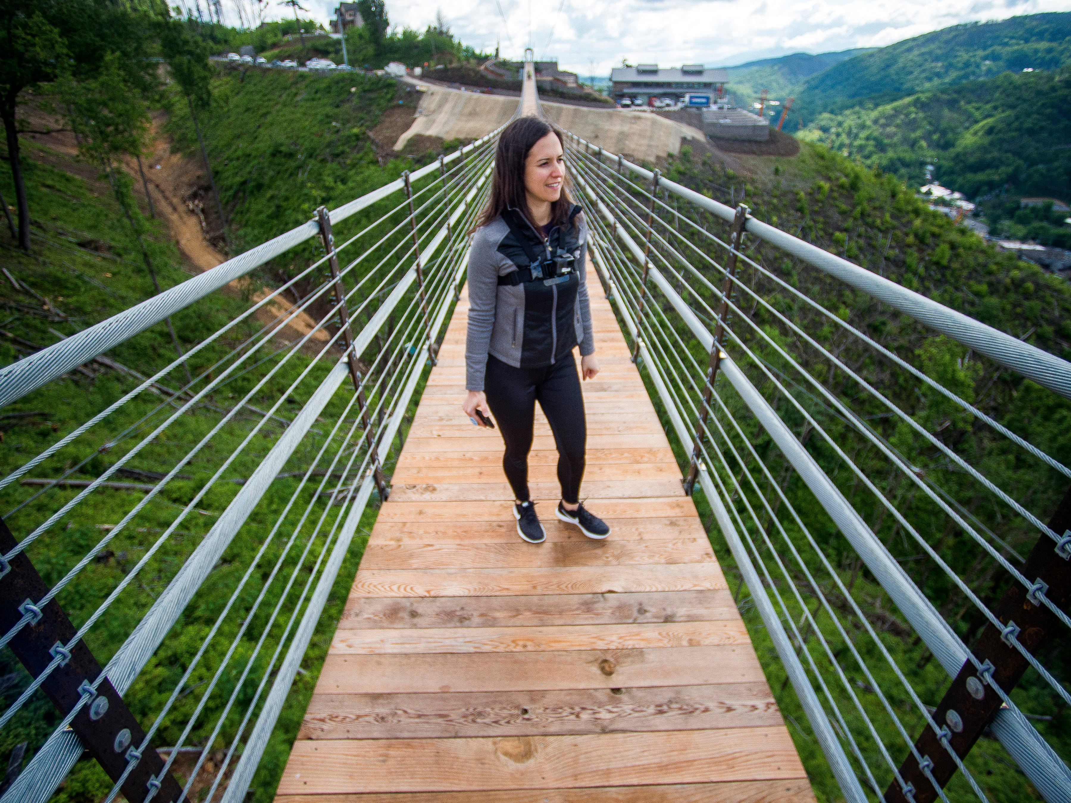 Knoxville News Sentinel reporter Brenna Mcdermott takes in the view from the Gatlinburg SkyBridge, North America's longest pedestrian suspension bridge, on Tuesday, May 14, 2019.
