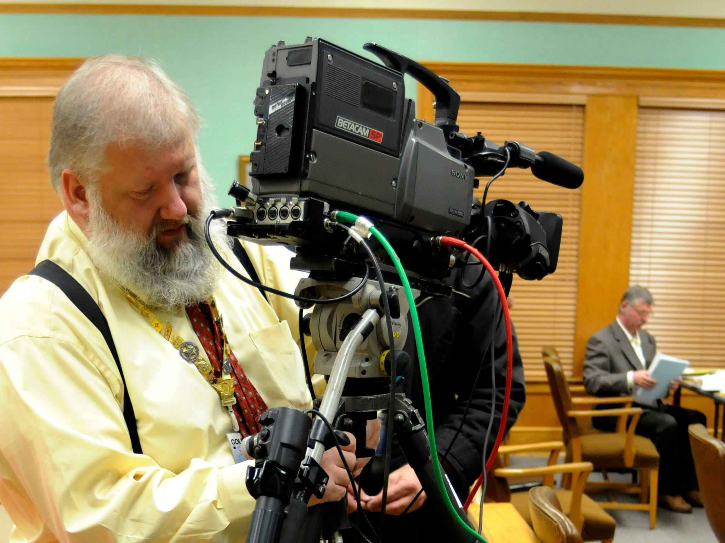 "Richard Friley, with Court TV, sets up a remote camera for viewing of the jury selection by the public. In the background top right is Rocky Houston who is on trial before Special Judge James R. ""Buddy"" Scott in Roane County Circuit Court. Houston is accused of ambushing Roane County Sheriff's Office Deputy William Birl Jones, 53, and ride-along Gerald Michael Brown, 44, in May 2006, killing them both. Houston, 45, contends he acted in self-defense and for years has been the target of a corrupt Roane County judicial system. He has filed dozens of lawsuits over a myriad of claims, ranging from allegations of insurance fraud to jury tampering.  Wednesday, December 3, 2008"