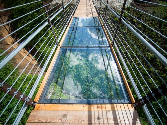 Glass-floor panels in the middle of the Gatlinburg SkyBridge on Tuesday, May 14, 2019. The SkyBridge is North America's longest pedestrian suspension bridge and offers panoramic views of Gatlinburg and the Smoky Mountains.