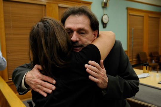 Clifford Leon Houston hugs his sister Lisa Burris immediately after he was found not guilty Thursday, Nov 12, 2009 of all charges in the May 2006 deaths of Roane County Sheriff's Office Deputy Bill Jones and his ride-along friend Gerald Michael Brown.