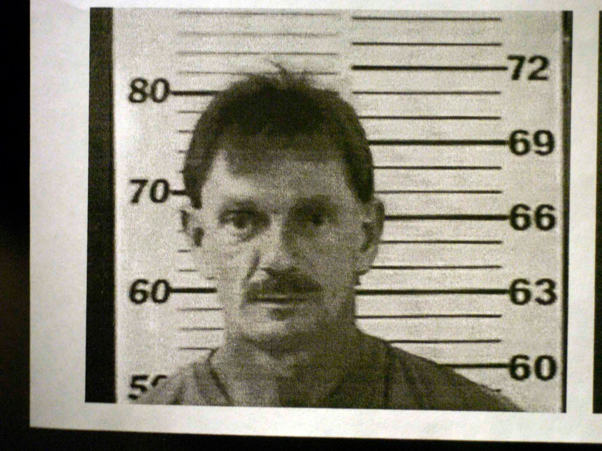 "Copy of the police mug shot of the suspect Clifford Leon Houston, 412 Barnard Narrows Road, Ten Mile, TN who officers are looking for.  (his DOB 12/15/1958, white male, 6'1"", 160 lbs., Brown hair, Brown eyes, father: Clyde Houston)"