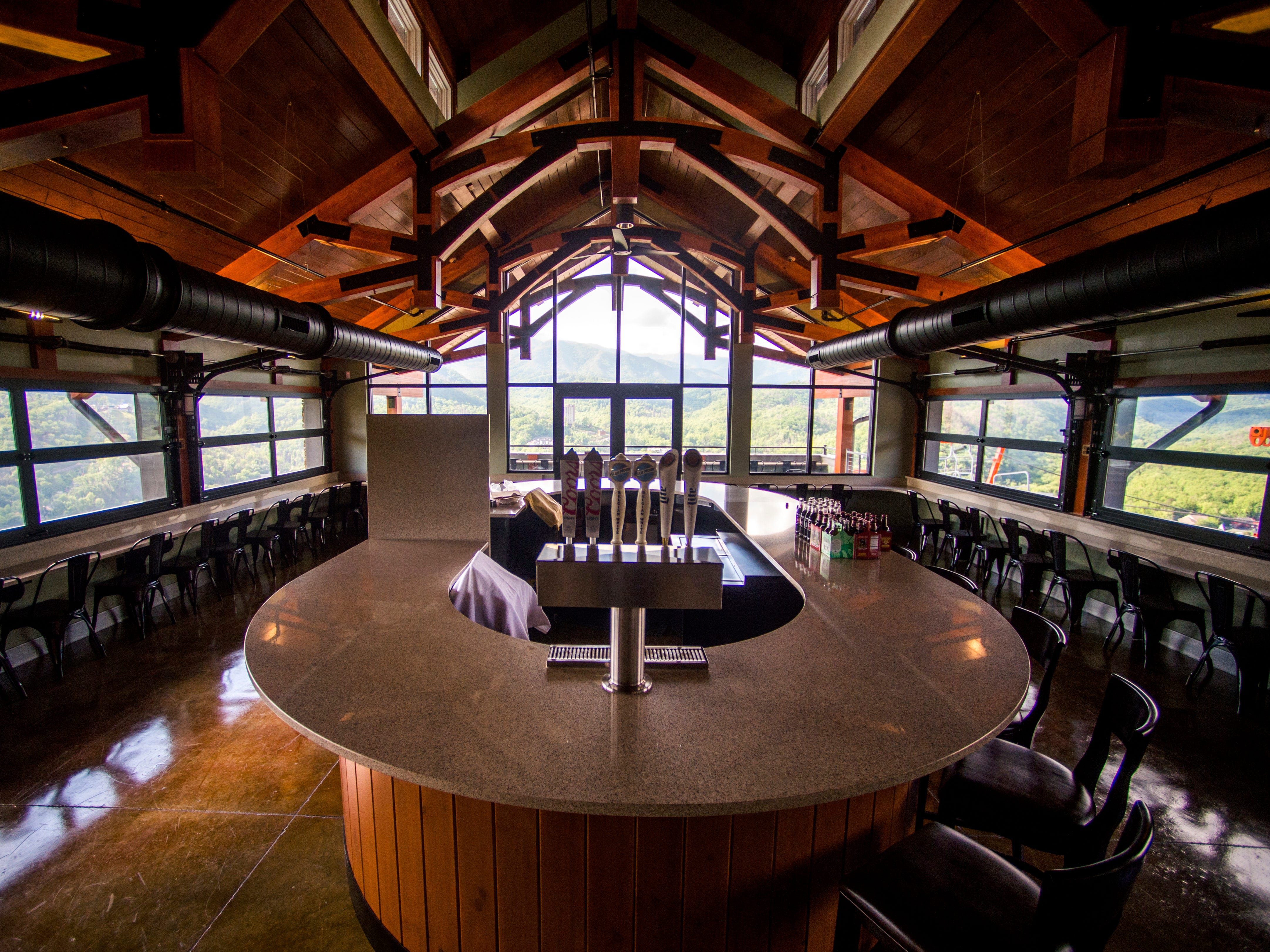 A bar area in the SkyDeck portion of the Gatlinburg SkyLift Park offers panoramic views of Gatlinburg and the Smoky Mountains.