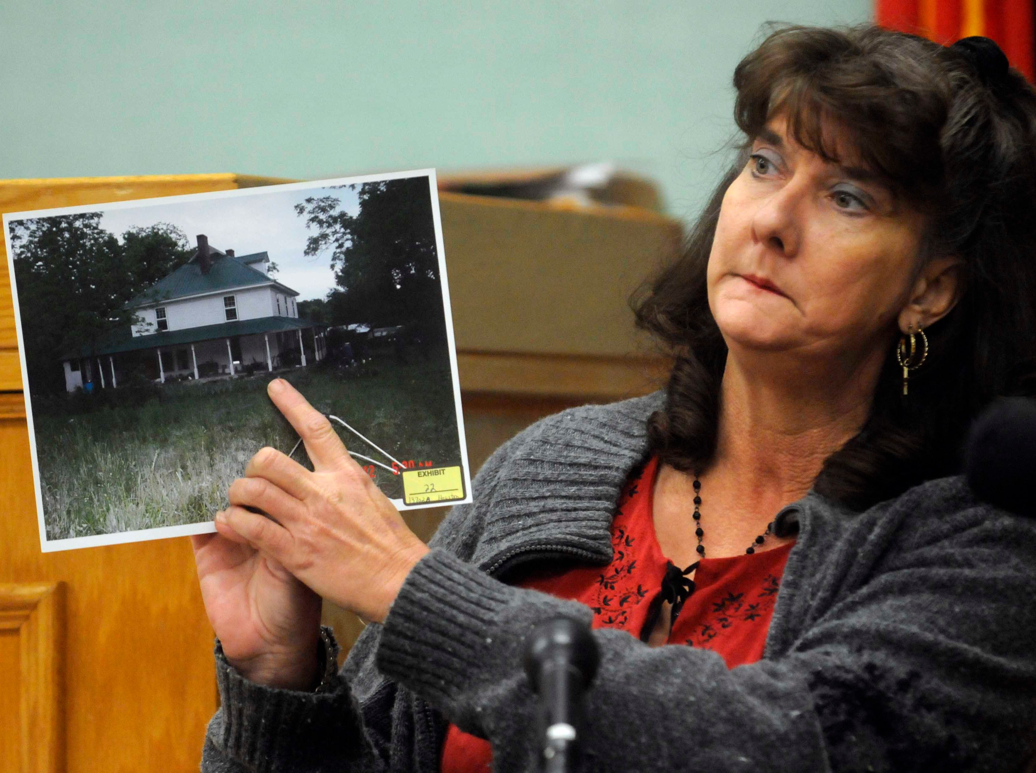 Ann Watts points to a photograph as she described where she was sitting the day of the shooting on Barnard Narrows Road in May 2006.  Testimony continued Friday, Nov 6, 2009 in the double murder trial of Clifford Leon Houston in Roane County Circuit Court. Houston is accused of the May 2006 ambush murders of Roane County Sheriff's Office Deputy William Birl Jones, 53, and his ride-along friend Gerald Michael Brown, 44.
