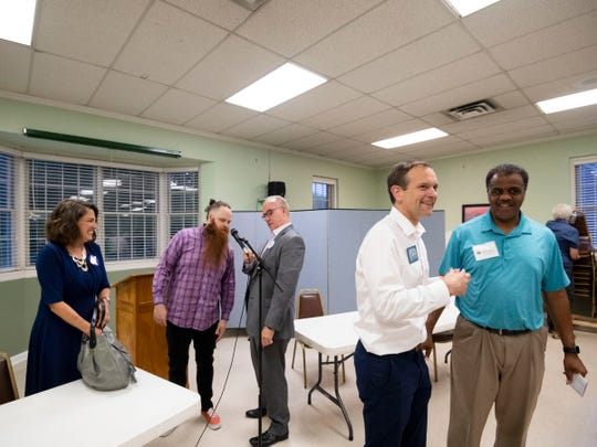 Knoxville mayoral candidate, right, Marshall Stair talks with former Knox County commissioner Sam McKenzie as other mayoral candidates gather, from left, Indya Kincannon, Fletcher Burkhardt, and Eddie Mannis after the mayoral candidate forum at Eastminster Presbyterian Church on Monday, May 13, 2019.