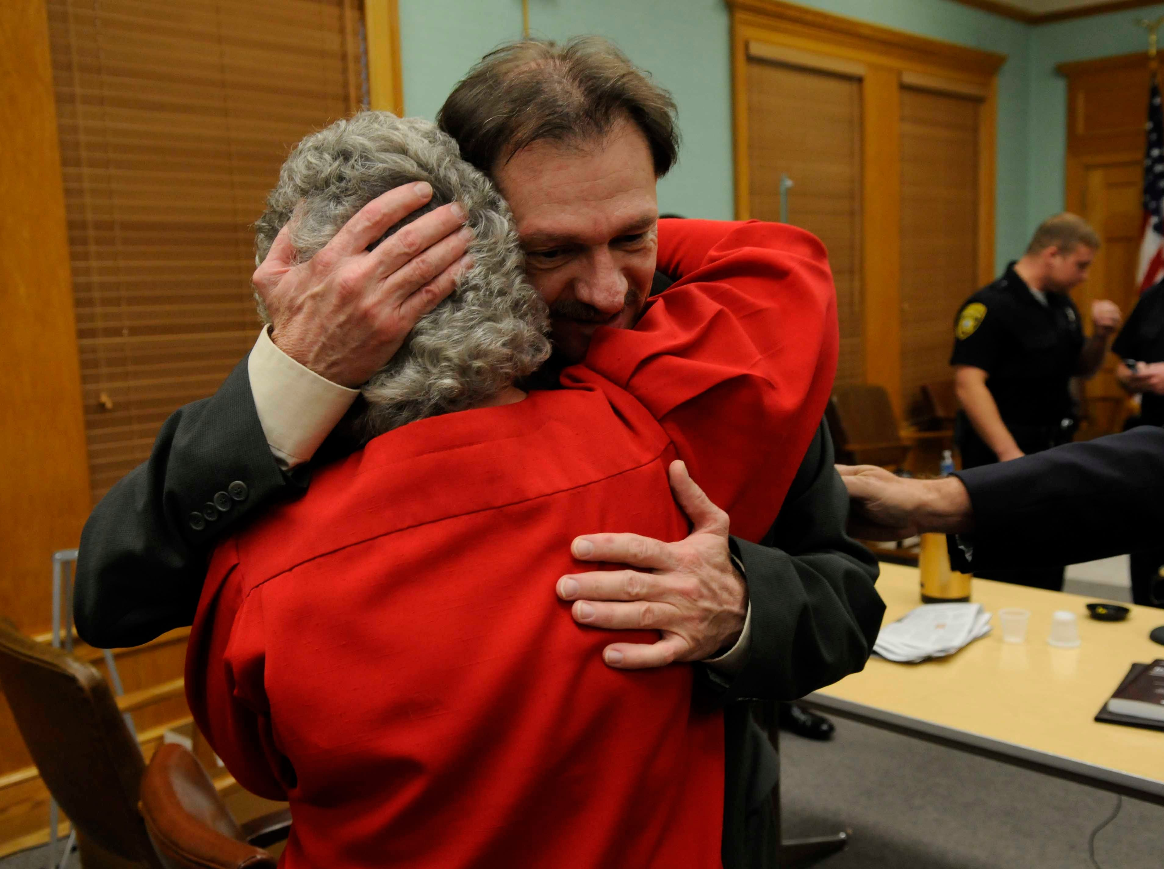 Leon Houston hugs his neighbor Ruby Lowe after he was found not guilty of double murder charges Thursday, Nov 12, 2009 in Roane County Criminal Court. Houston, 50, was cleared of responsibilty for the May 2006 shooting deaths of Roane County Sheriff's Office Deputy Bill Jones and his ride-along friend Mike Brown.
