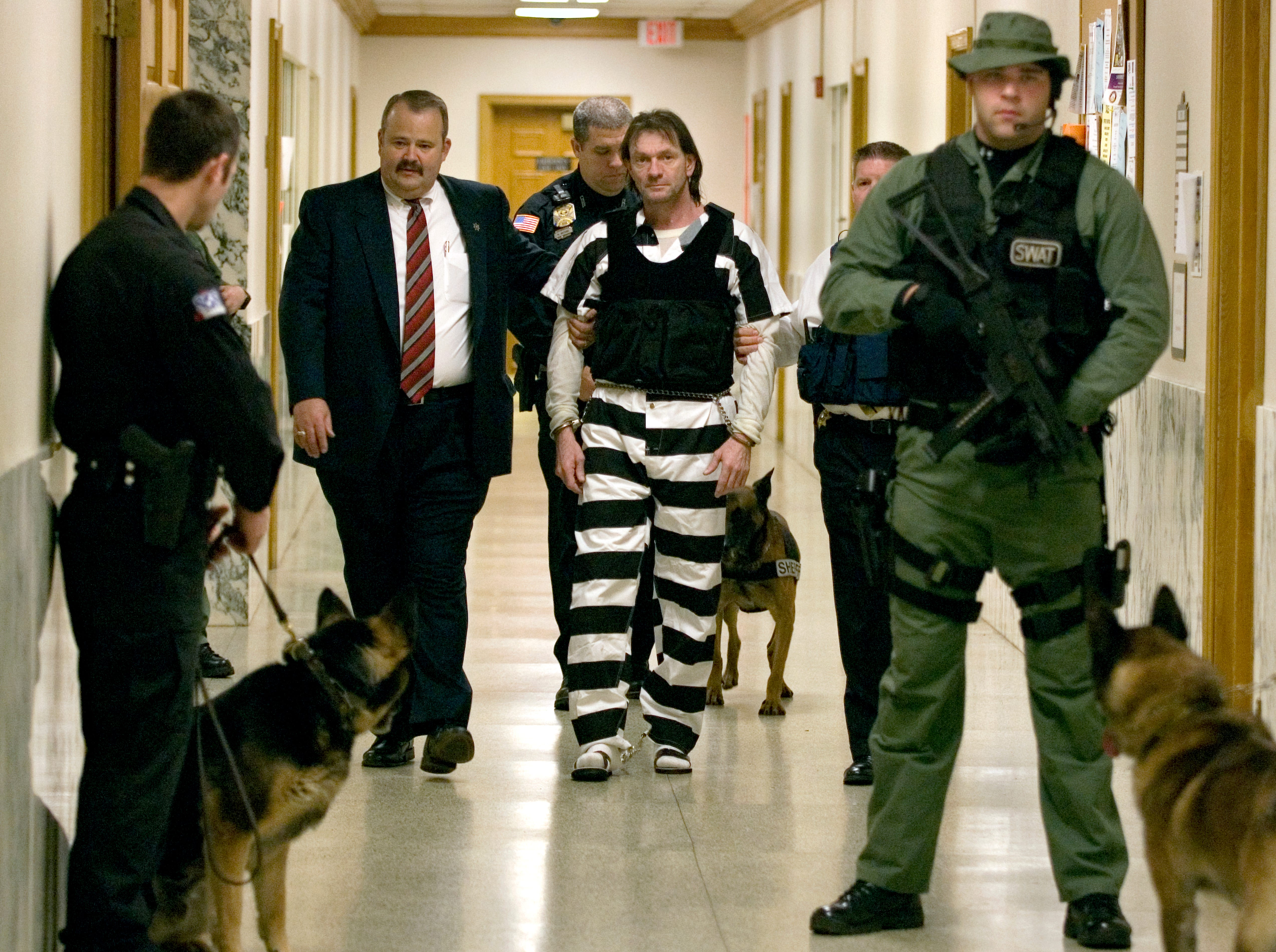 Clifford Leon Houston, 47, is lead into a courtroom in Roane County to hear the result of a mental evaluation Friday. He was found competent to stand trail in the fatal shooting of Roane County Sheriff's Deputy Birl Jones, 53, and ride-along partner Gerald Michael Brown, 44.  1/12/07