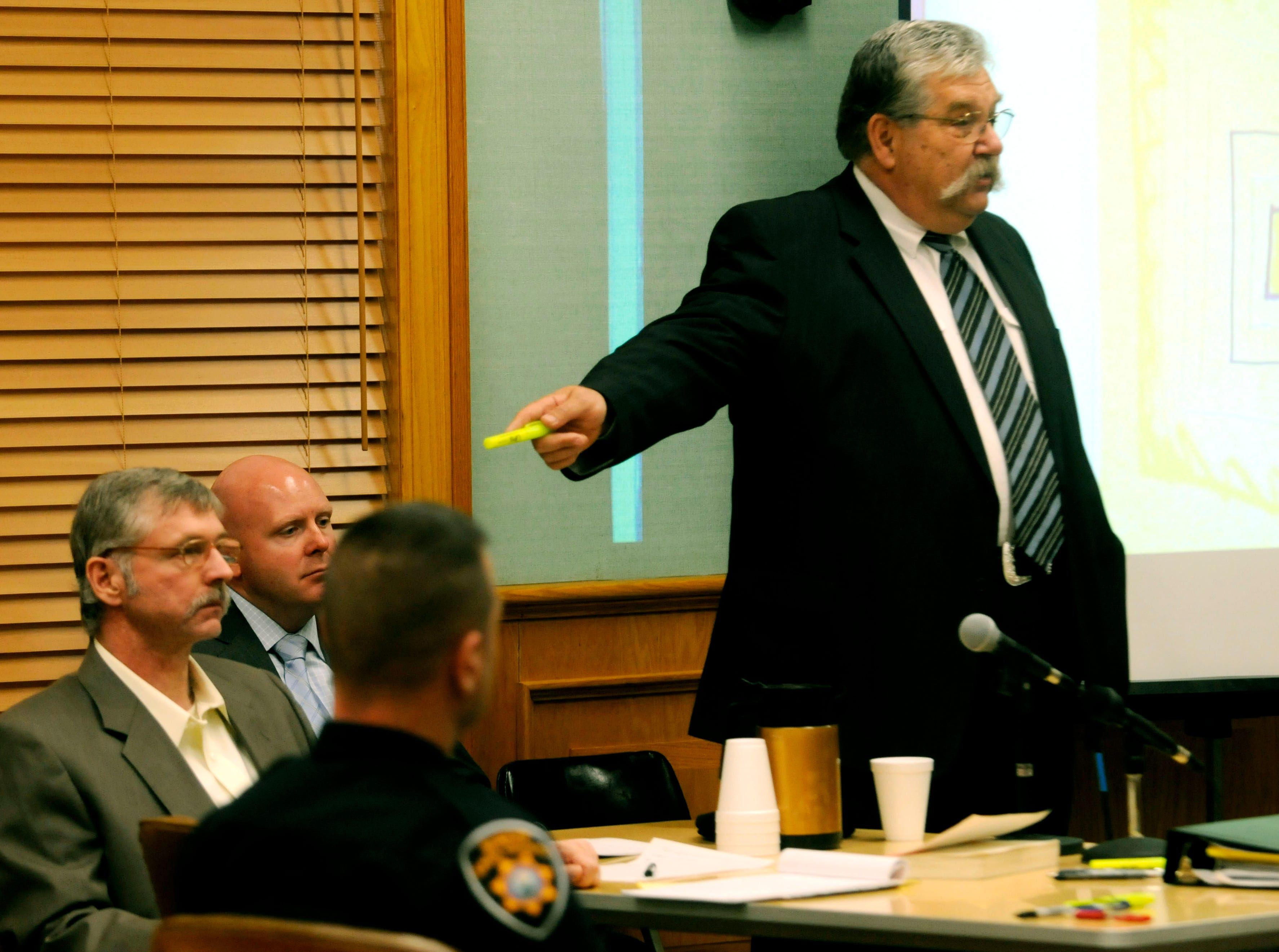 Rocky Houston's defense attorney Randy Rogers, right, points to Houston during his opening statement telling the jury he was a honest hardworking family man with a top security clearance before this incident. Houston is accused of ambushing Roane County Sheriff's Office Deputy William Birl Jones, 53, and ride-along Gerald Michael Brown, 44, in May 2006, killing them both. Houston, 45, contends he acted in self-defense and for years has been the target of a corrupt Roane County judicial system.  Friday, December 5, 2008