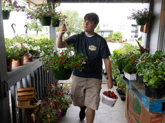 Jake Ensor, 15, is working his first job at Pratt's Country Store on Monday, May 13, 2019. His work includes cleaning, carrying groceries for customers, and generally helping out around the store wherever needed.