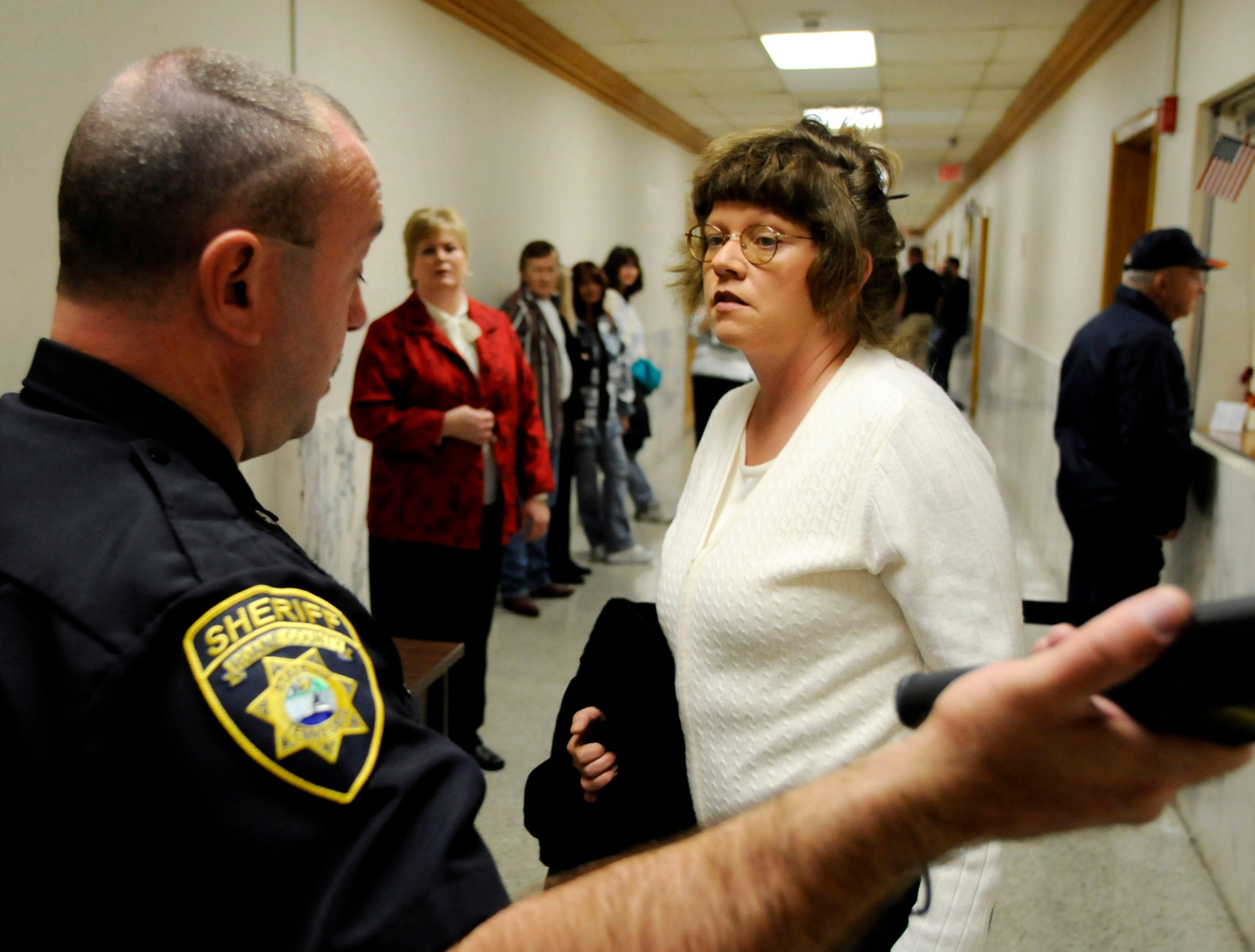 Rocky Houston's sister, Debbie Cofer, is questioned at the security checkpoint if she is a witness. Potential witnesses, like Houston's wife, Nancy Houston, center in red coat, were not allowed to watch jury selection. Monday, November 10, 2008