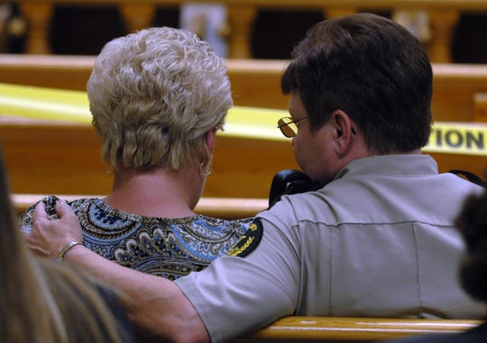 The widow of William Birl Jones is comforted by Roane County Capt. Fay Hall in the courtroom Wednesday afternoon. Rocky Joe Houston and Clifford Leon Houston appeared before Criminal Court Judge James Buddy Scott on first degree murder in the death of Deputy William Birl Jones and his ride along friend Gerald Michael Brown.