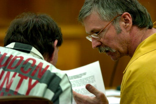 "Rocky Joe Houston, right, talks to his brother Leon Houston, left, following Special Judge James R. ""Buddy"" Scott's ruling Friday in Kingston to separate their trials . Rocky Houston and his brother Clifford Leon Houston are accused in the death of Roane County Sheriff's Department Deputy William Birl Jones and ride-along Gerald Michael Brown last May."