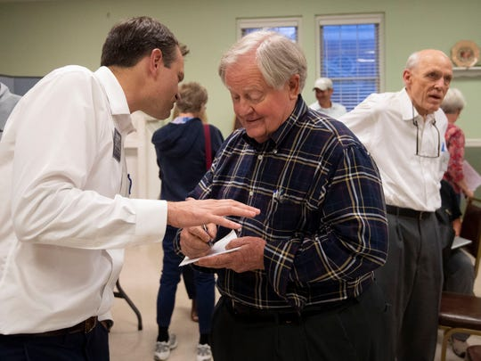 Knoxville mayoral candidate Marshall Stair talks with former Knoxville mayor and U.S. ambassador Victor Ashe at Eastminster Presbyterian Church on Monday, May 13, 2019.