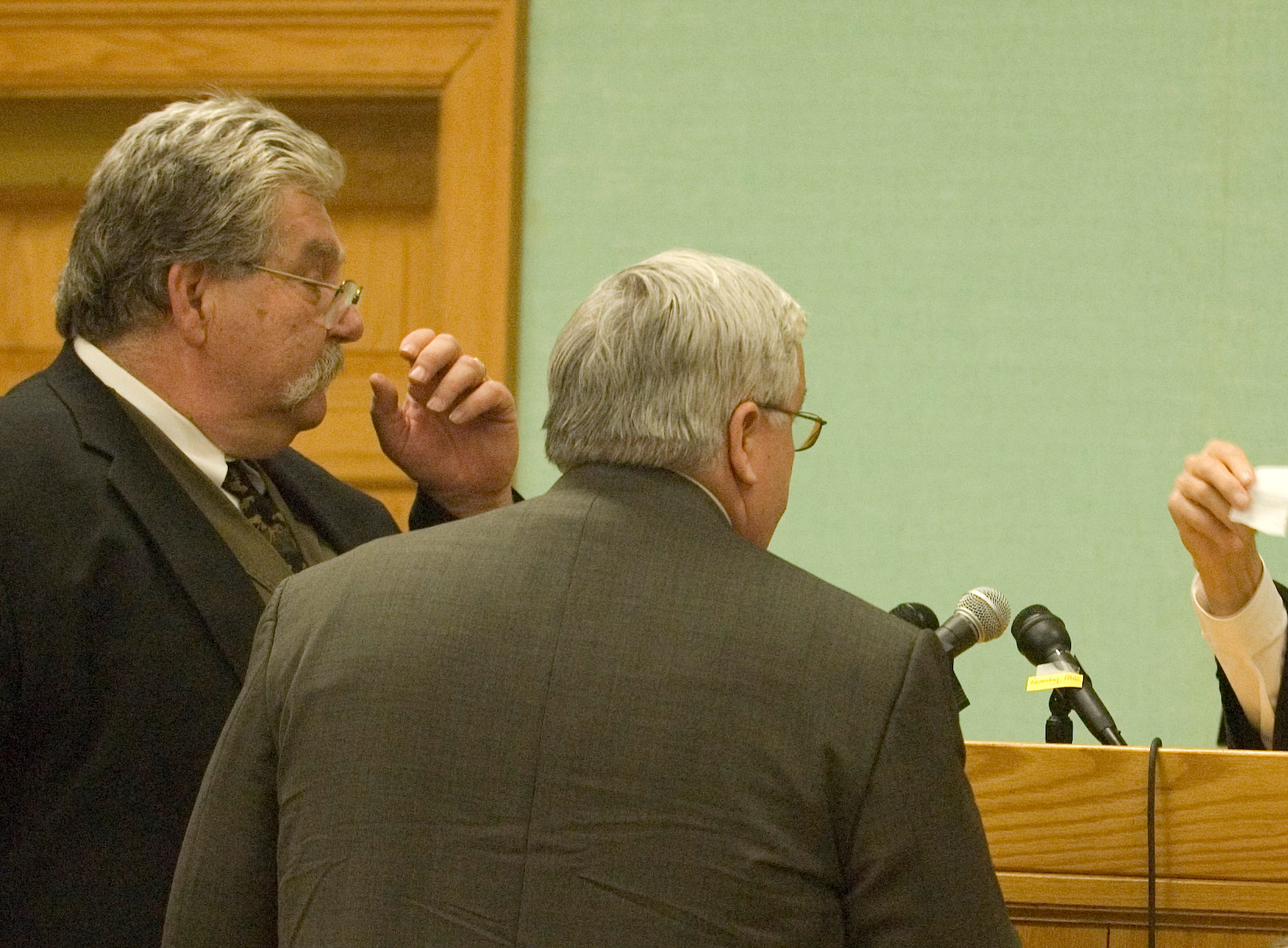 """Special Judge James """"Buddy"""" Scott, right, talks over a question from the jury Friday with special prosecutor Ken Irvine, center, and defense lawyer Randy Rogers, left, during the third day of deliberations of the Rocky Joe Houston trial. Friday, December 19, 2008"""