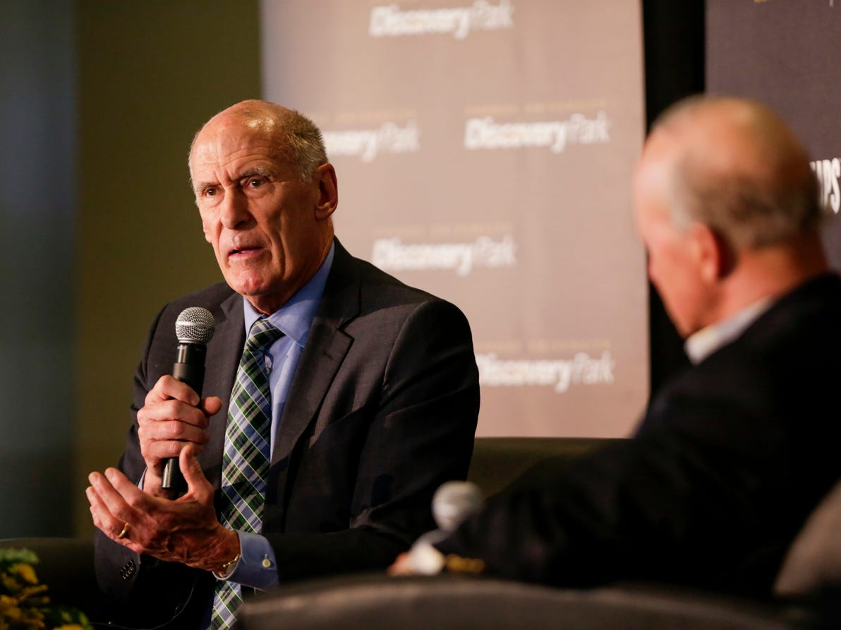 """Director of National Intelligence Daniel Coats speaks with Purdue University president Mitch Daniels during the Symposium on Ethics, Technology and the Future of War and Security, Tuesday, May 14, 2019, at Purdue University in West Lafayette.  The talk, """"What IF Artificial Intelligence Wages War?,"""" is part of Purdue's Ideas Festival, a series of events tied to the university's 150th anniversary."""