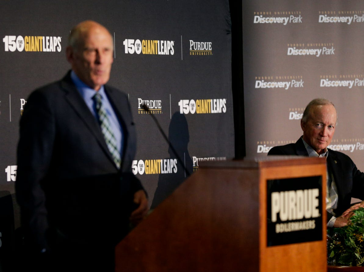 """Purdue University president Mitch Daniels listens as Director of National Intelligence Daniel Coats speaks during the Symposium on Ethics, Technology and the Future of War and Security, Tuesday, May 14, 2019, at Purdue University in West Lafayette.  The talk, """"What IF Artificial Intelligence Wages War?,"""" is part of Purdue's Ideas Festival, a series of events tied to the university's 150th anniversary."""