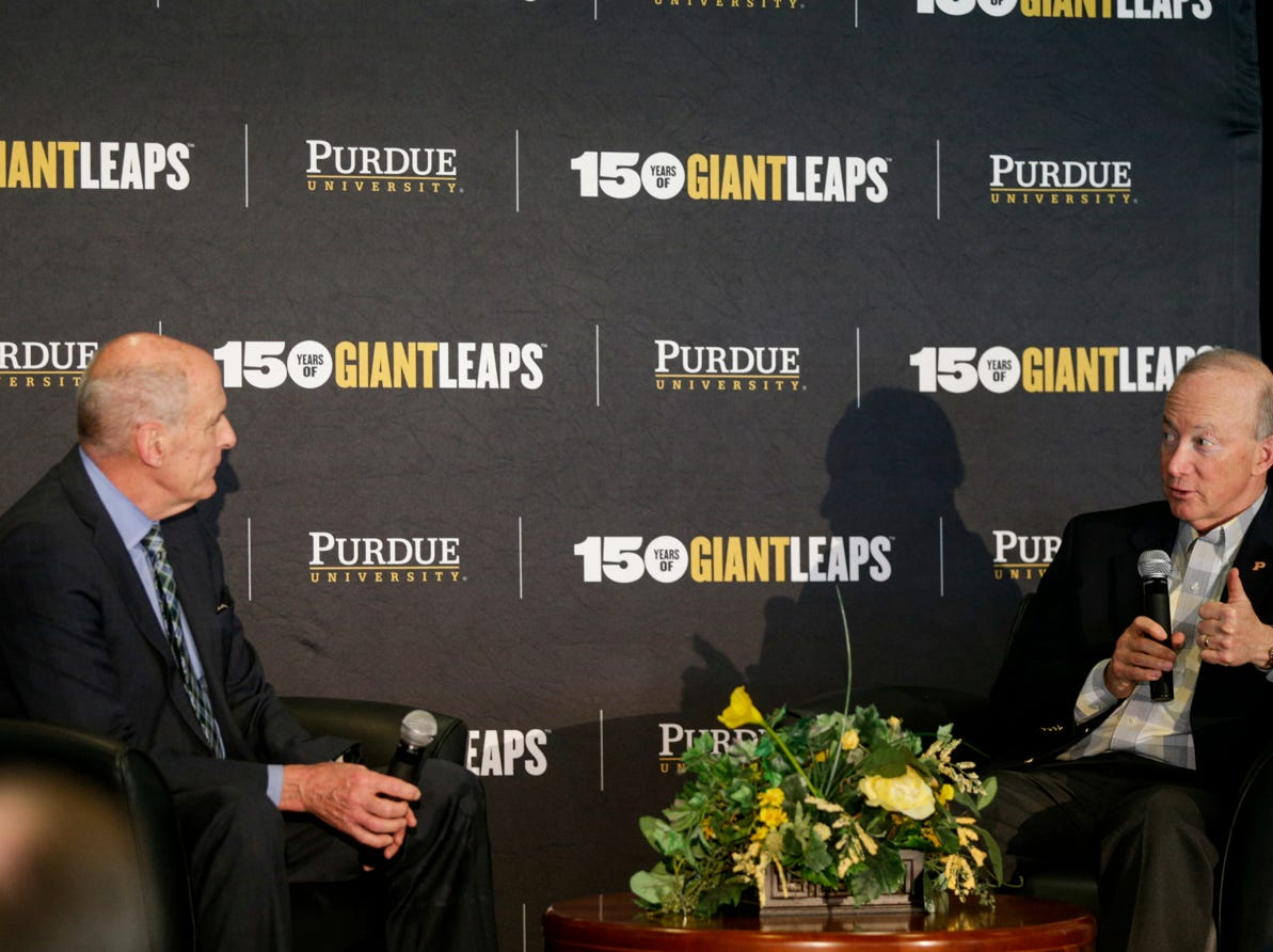 """Purdue University president Mitch Daniels, right, asks a question to Director of National Intelligence Daniel Coats during the Symposium on Ethics, Technology and the Future of War and Security, Tuesday, May 14, 2019, at Purdue University in West Lafayette.  The talk, """"What IF Artificial Intelligence Wages War?,"""" is part of Purdue's Ideas Festival, a series of events tied to the university's 150th anniversary."""