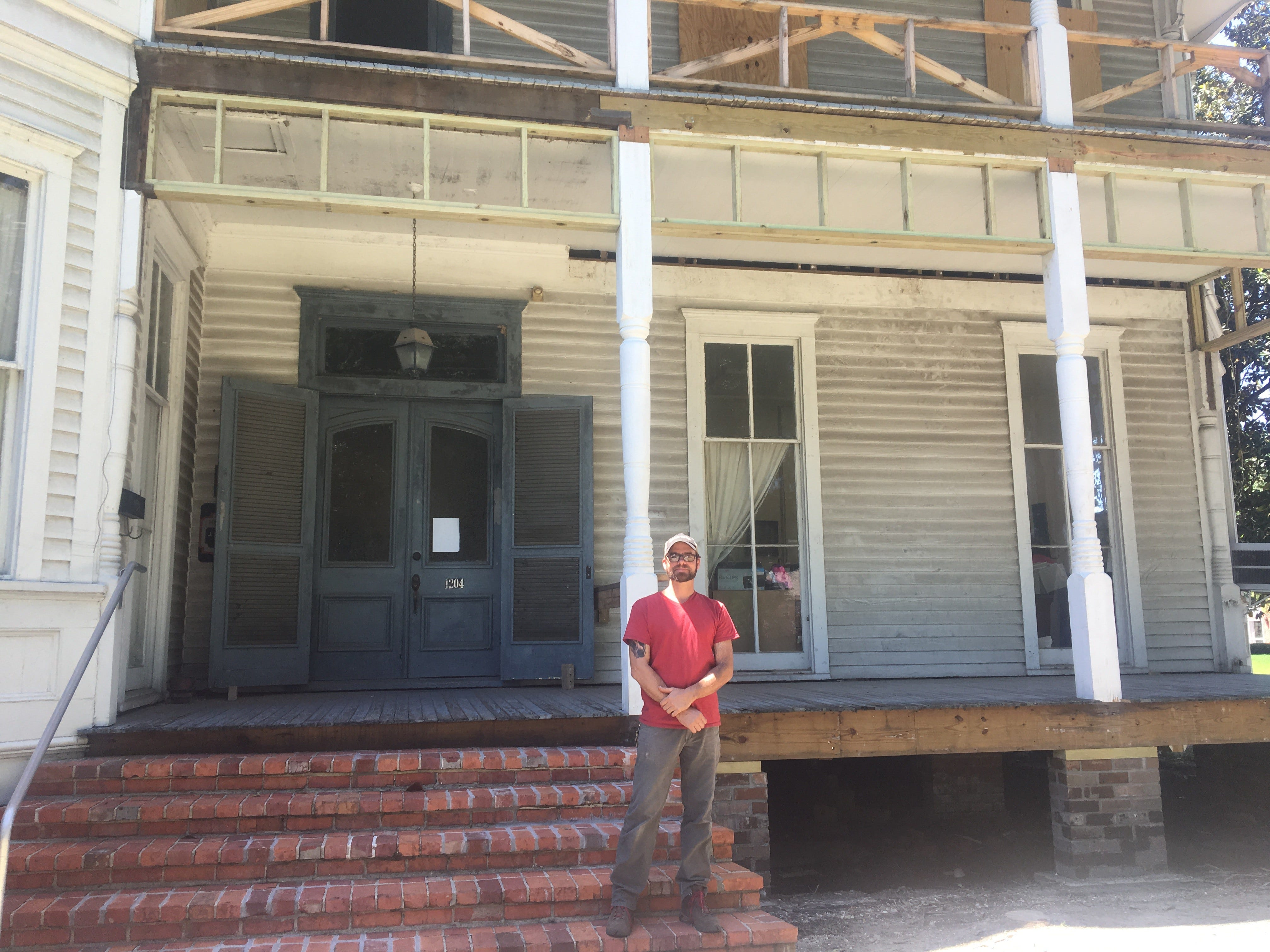 Geoff Thompson stands in front on the steps of The Roy House. The rot in the porch and foundation has been removed but he says that's just a tenth of the work.