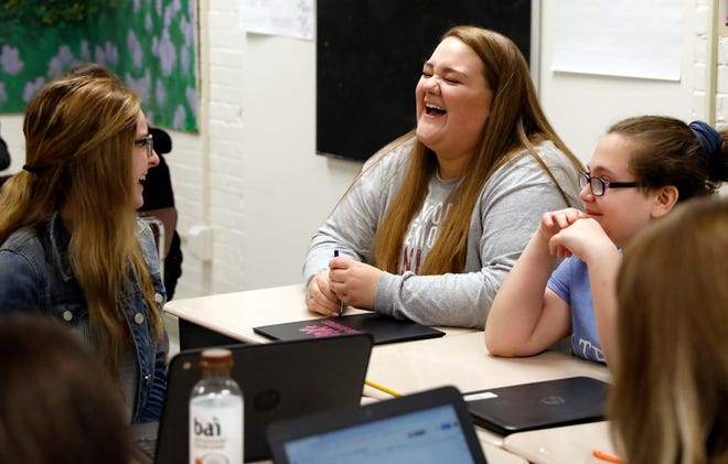 Jana Lenart, right, a senior at Berne Union High School, laughs with Cloee Walton, left, and Audrey Gordish Monday morning, May 14, 2019, during a meeting of the school's Ruling Our Experiences group in Sugar Grove. The group focuses on helping female students empower themselves.