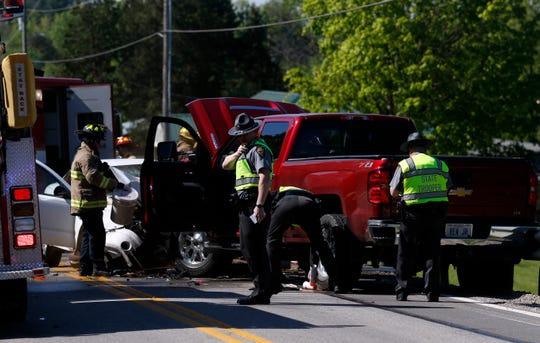Ohio Highway Patrol Sgt. Kyle Mackie, center, talks on his radio as troopers investigate a three vehicle crash Tuesday morning, May 14, 2019, in Clearcreek Township. One person was taken to Fairfield Medical Center in Lancaster for treatment and another was flown to Grant Medical Center in Columbus. The crash closed the highway for more than two hours.