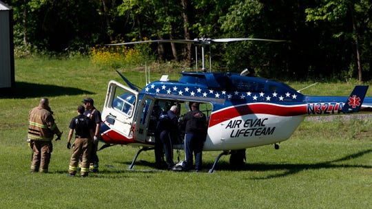 A person is loaded onto a medical helicopter before being flown to Grant Medical Center in Columbus Tuesday morning, May 14, 2019, in Clearcreek Township. The person being flown was involved in a three vehicle on Ohio 159 that sent one other person to Fairfield Medical Center.