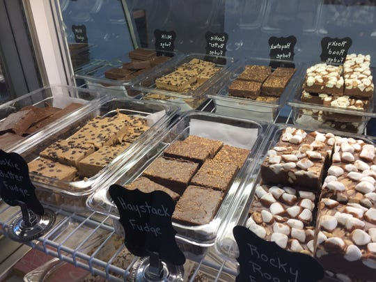 An assortment of fudge bars, shown Tuesday, May 14, 2019, are among many sweets Total Cluster Fudge owner and baker Alisa Shakespeare is making as she prepares to open her new shop in Brighton.