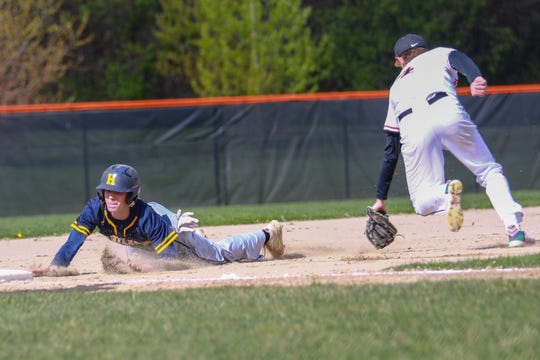 Hartland's Brenden Tome dives into third base after a failed pickoff attempt at first in a 4-2 loss to Brighton on Monday, May 13, 2019.