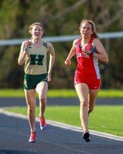 Howell's Ashlyn Tait (left) set the school record in the 800 meters, ran on a record-setting 1,600 relay team and came within two seconds of the 1,600 mark.