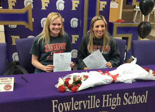 Fowlerville track and field teammates Mackenzie Brigham (left) and Kyla Chappell signed Tuesday with Davenport University.