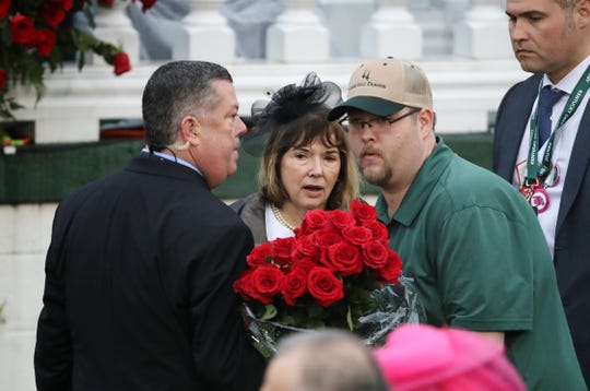 Maximum Security owner Mary West (center) in the winners circle during an objection after jockey Luis Saez led the pack to finish first in the Kentucky Derby at Churchill Downs, but was later disqualified and Country House was declared the winner.